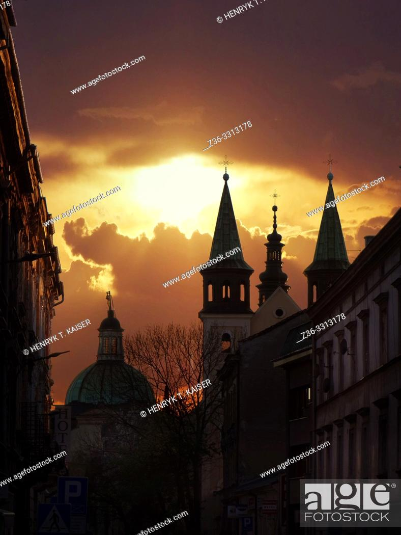 Stock Photo: Carmelite Church and Garbarska street at sunset clouds, Krakow, Poland.