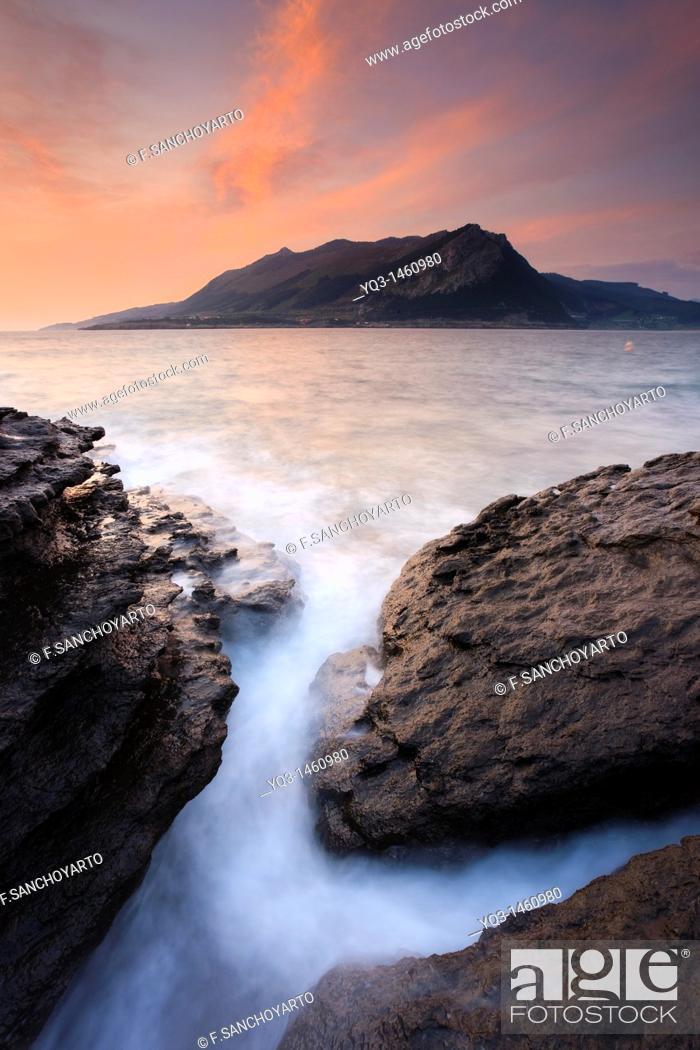 Stock Photo: Sunrise over the Montaña Oriental Costera, Castro Urdiales, Cantabria, Spain.