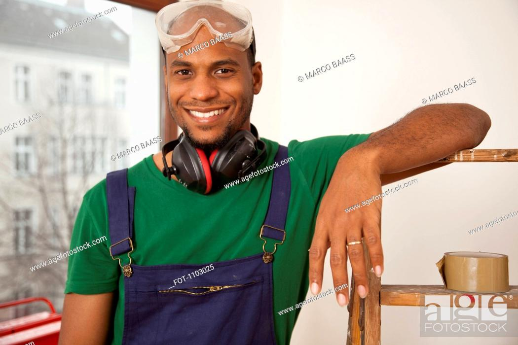 Stock Photo: A man preparing to do a home improvement project.