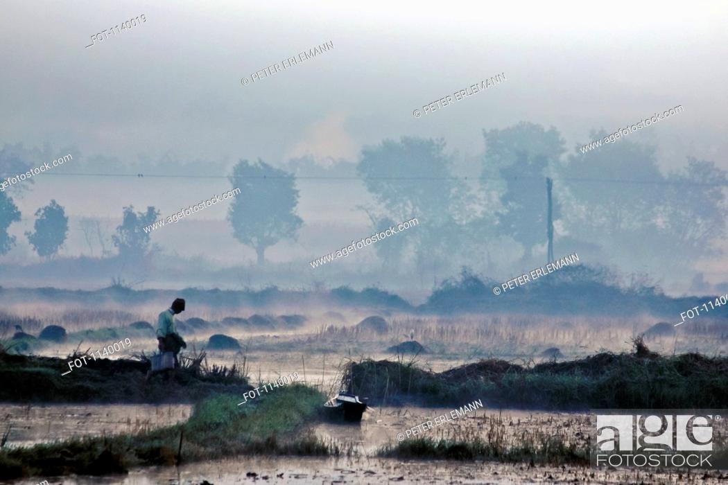 Stock Photo: A man walking in the morning, Inle Lake, Burma.