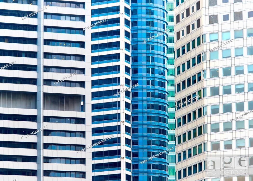 Stock Photo: View of a modern skyscrapes walls in Singapore. Background.