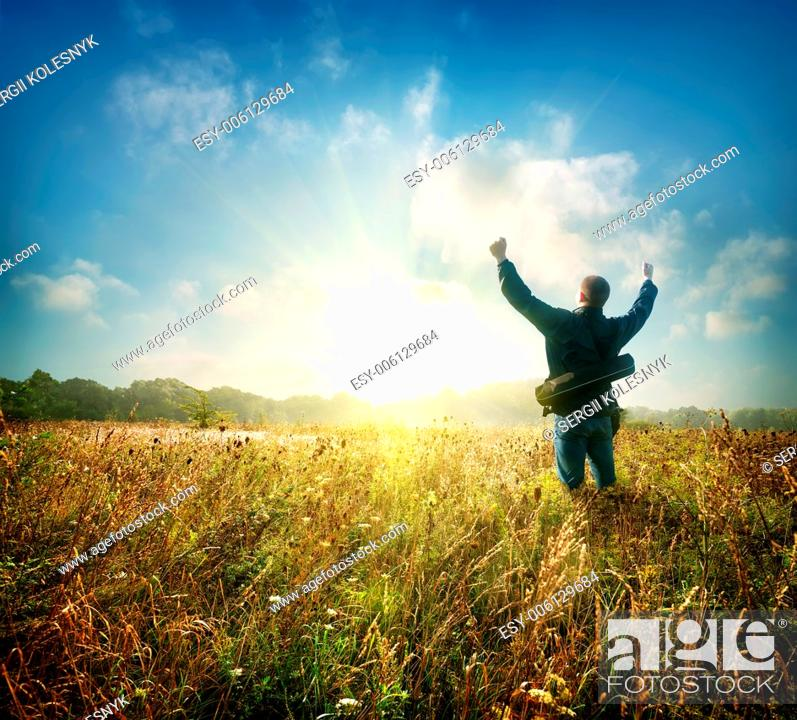 Stock Photo: Man in the field at sunrise in autumn.