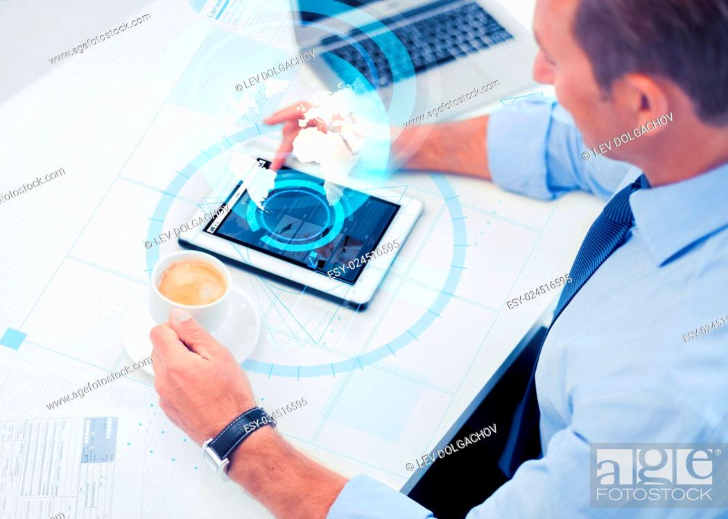 Stock Photo: business, people, mass media and technology concept - businessman with tablet pc reading internet news and drinking coffee in office.
