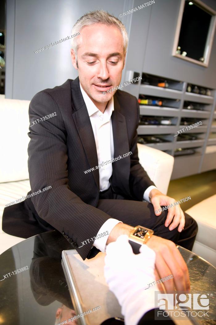 Stock Photo: Man buying a wristwatch.