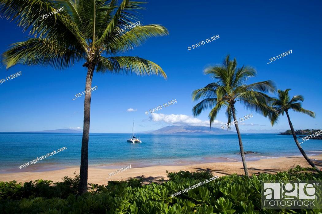 Stock Photo: Sailboat heads out at Makena Beach, Maui, Hawaii.