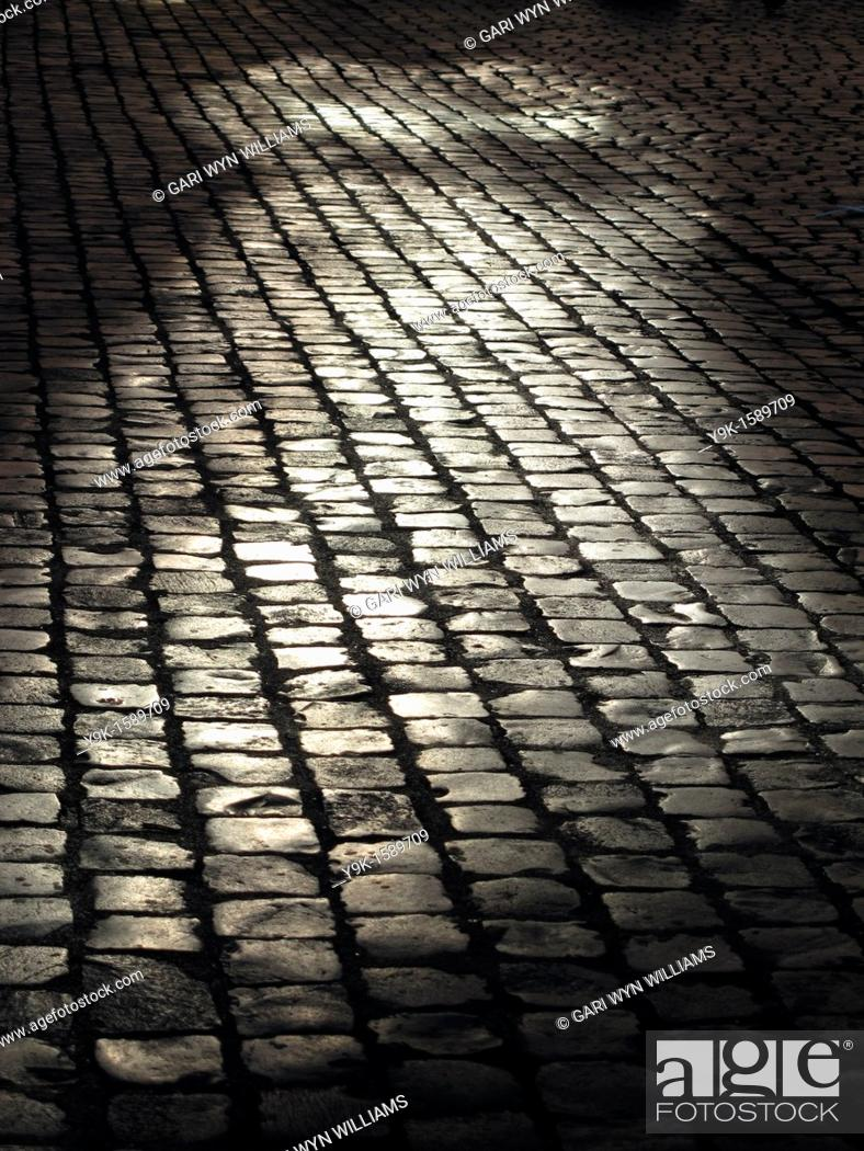 Stock Photo: Empty street with cobbles in Rome, Italy.