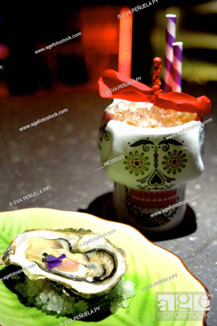 Stock Photo: Oyster and cocktail in a restaurant.