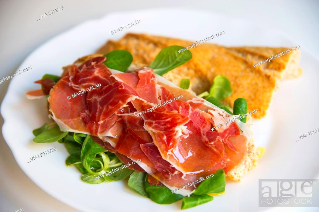 Stock Photo: Iberian ham with water cress and olive oil on slied bread. Spain.