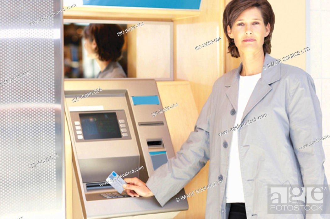 Stock Photo: Woman at cashpoint.