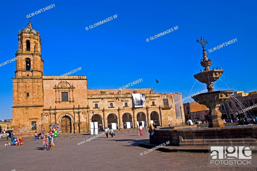 Stock Photo: Group of people in front of a church, Church of San Francisco, convent of San Francisco, Plaza Valladolid, Morelia, Michoacan State, Mexico.