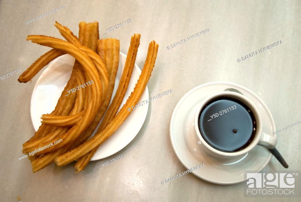 Imagen: hot chocolate dipping sauce served in a cup and plate of churros, San Gines chocolateria in Madrid, Spain, Europe.