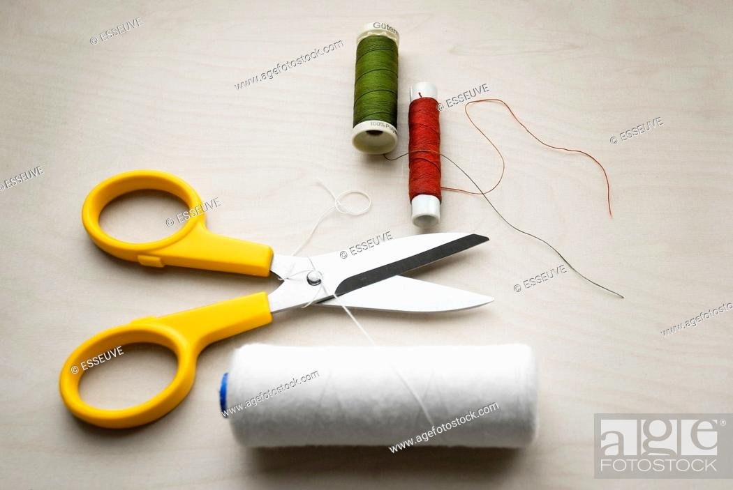 Stock Photo: Dressmaking and Scissors and Thread.