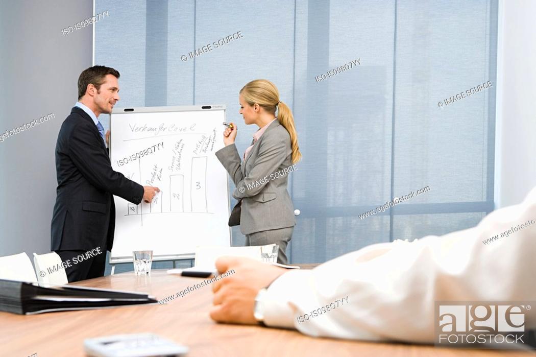 Stock Photo: Colleagues giving presentation.