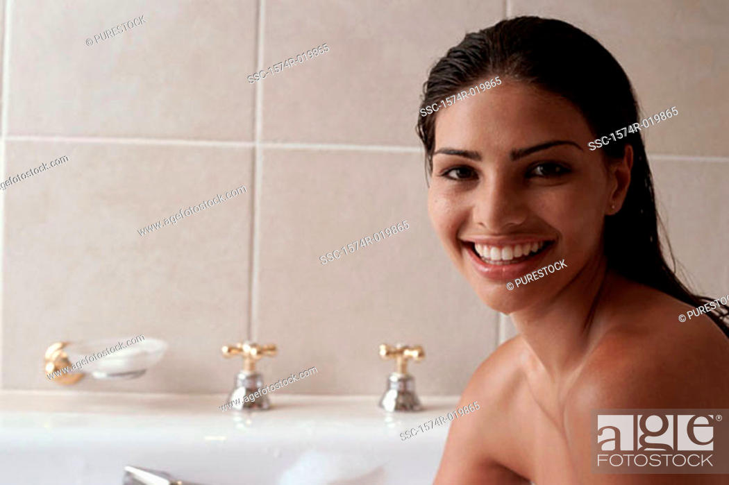Stock Photo: Portrait of a young woman taking a bubble bath.