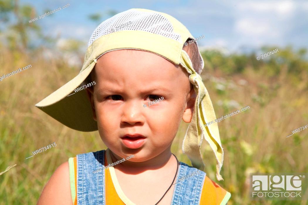 Stock Photo: little boy on a meadow.