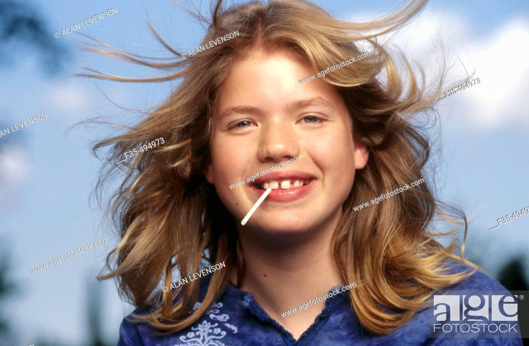 Stock Photo: Headshot of Adolescent girl with Lollipop.