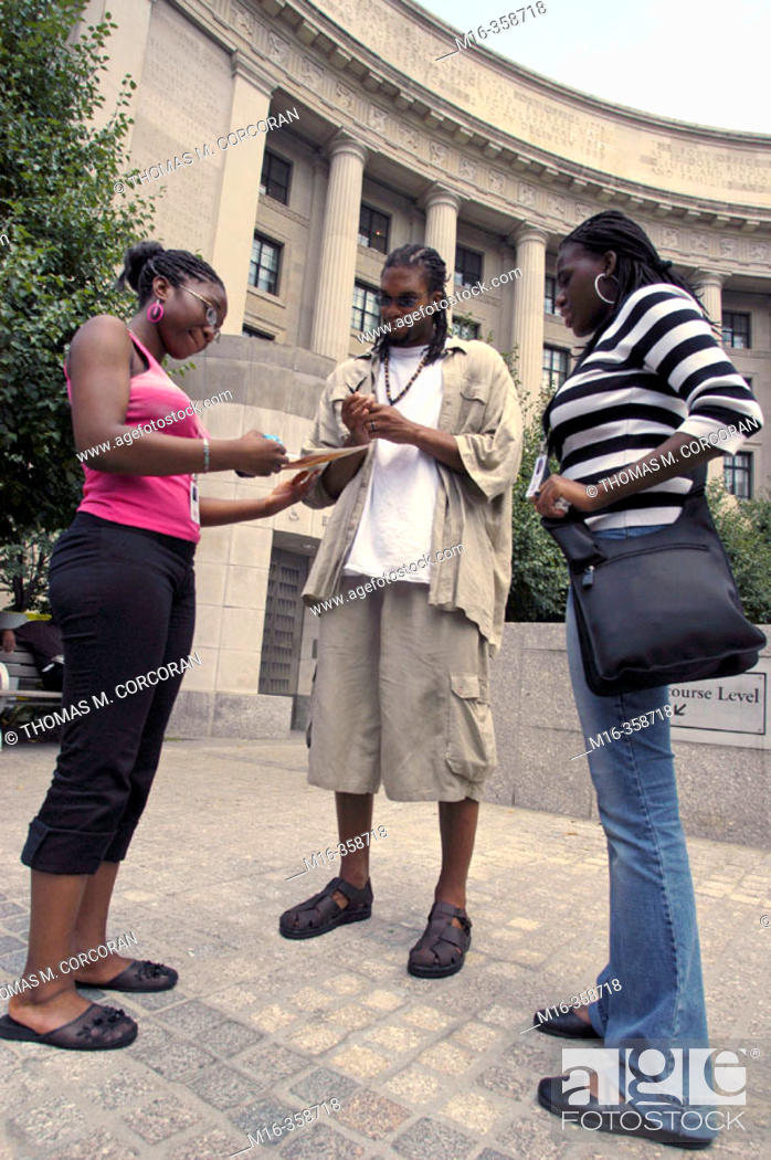"""Stock Photo: Etan Thomas of the Washington Wizards signs some autographs and talks with fans during the DC hip hop Theatre Festival, during the Fest's """"Poetry Slam""""."""
