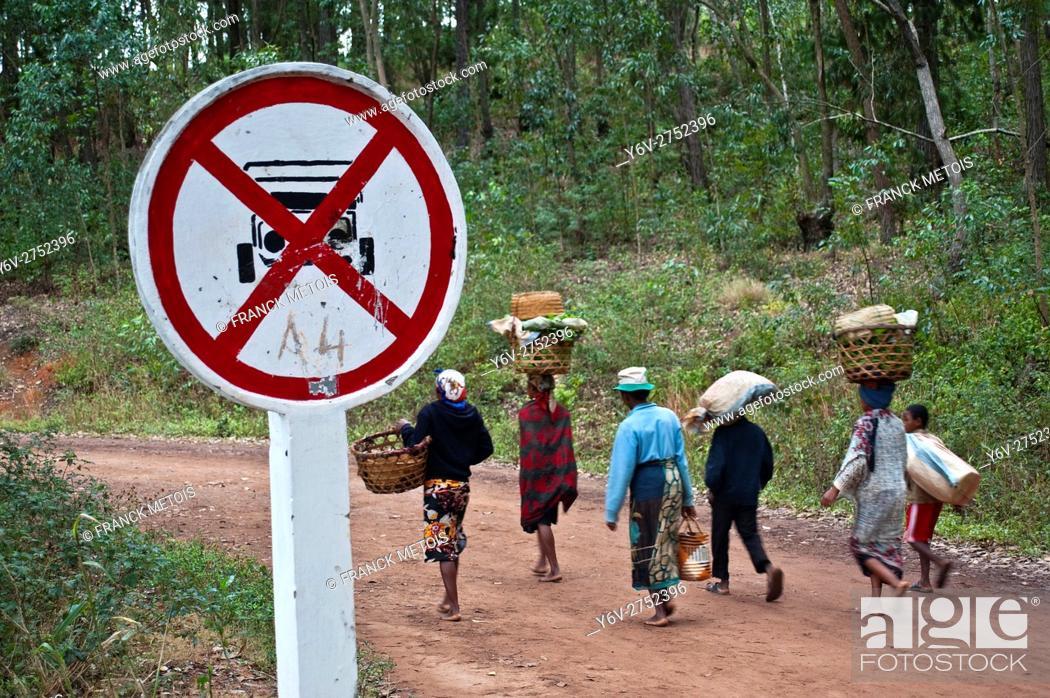 Stock Photo: No vehicle road sign + local people walking on the road. Near Fianarantsoa ( Madagascar).