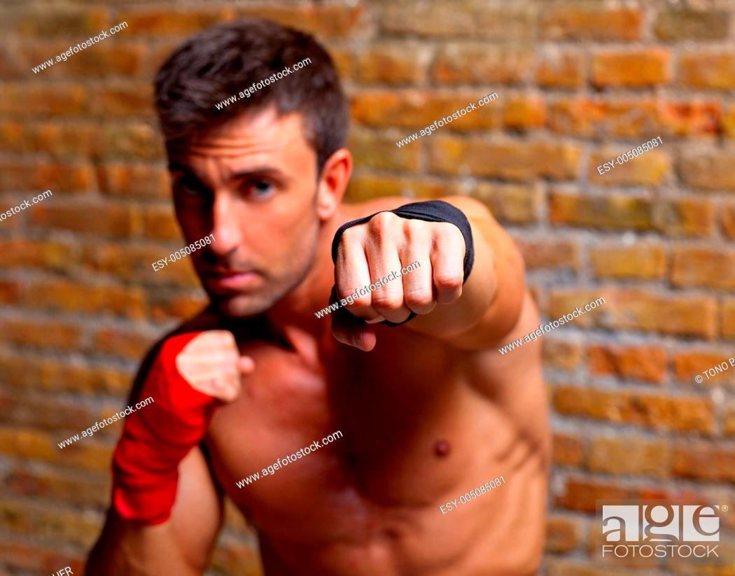 Stock Photo: muscle boxer shaped man fist to camera.