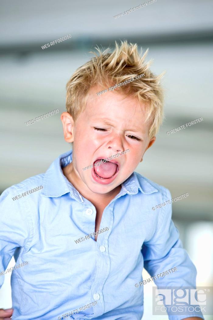 Stock Photo: Germany, Boy crying, close up.