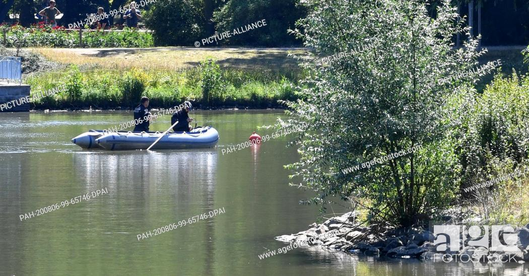 Stock Photo: 06 August 2020, Saxony, Leipzig: Forensics and the diving group of the police are searching for traces on the island pond in Clara-Zetkin-Park.