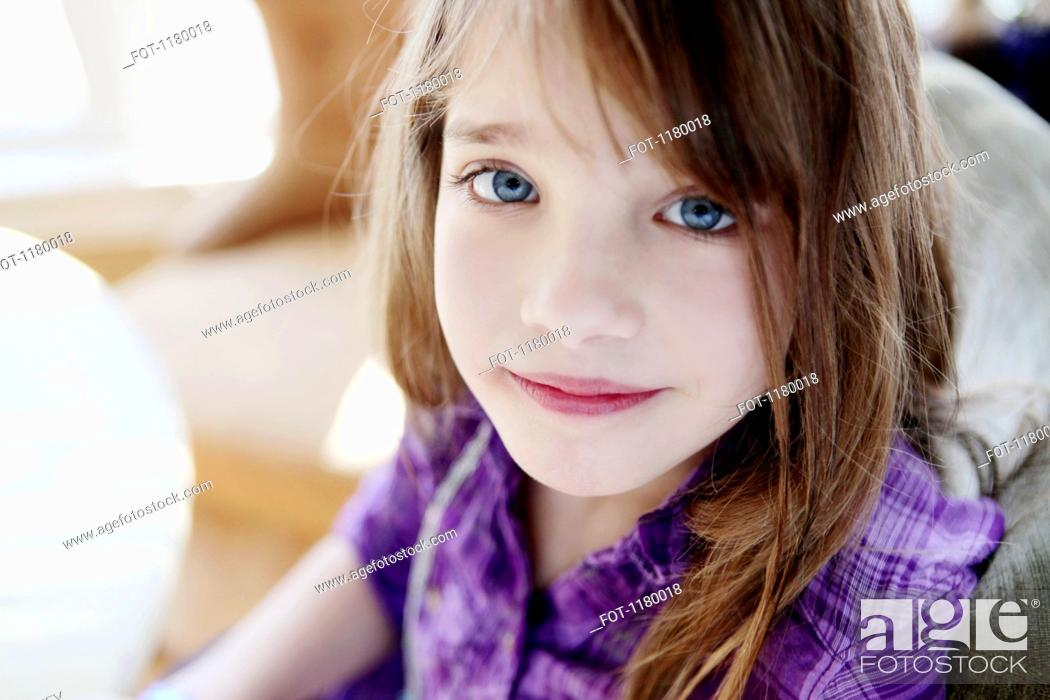 Stock Photo: A young girl looking serenely into the camera.