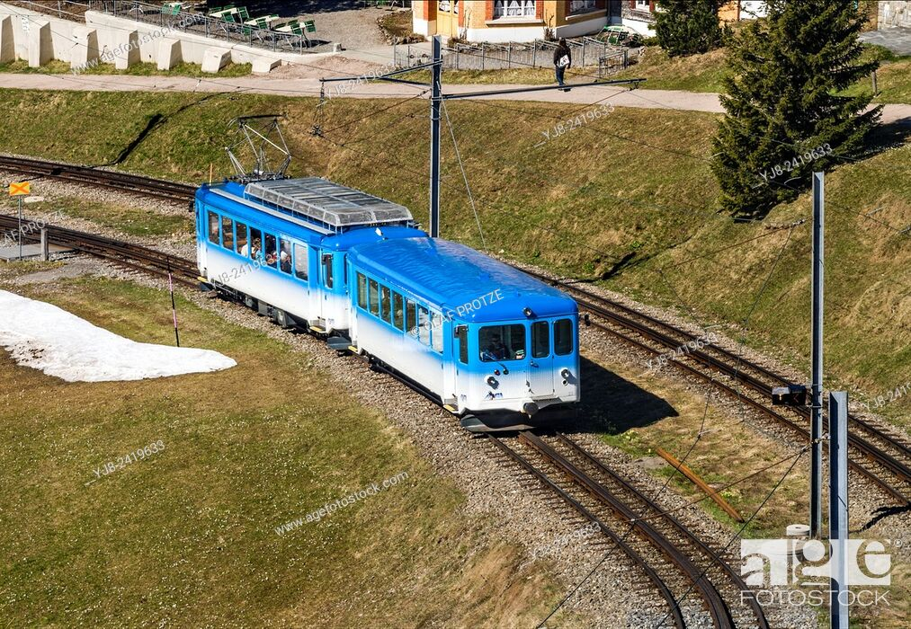 Stock Photo: Rigi train, run by Rigi Railways, going up Mt. Rigi (Rigi-Bahnen), Vitznau, Switzerland.