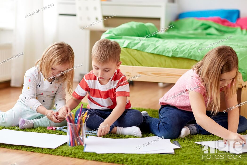 Stock Photo: happy creative kids drawing at home.