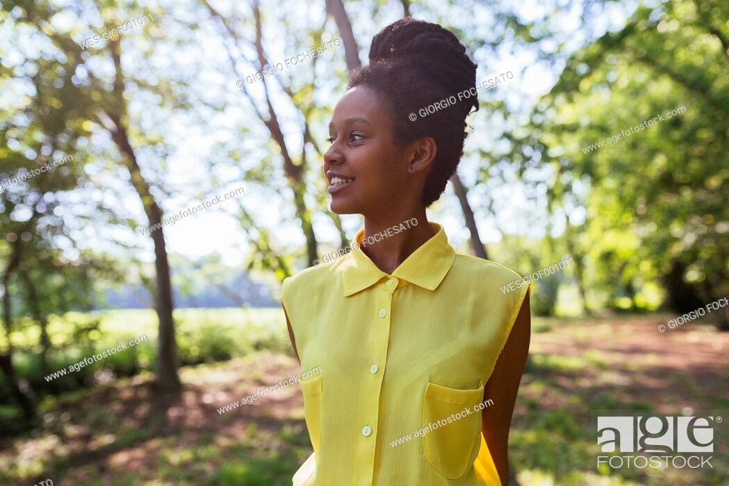 Stock Photo: Portrait of happy young woman in nature.