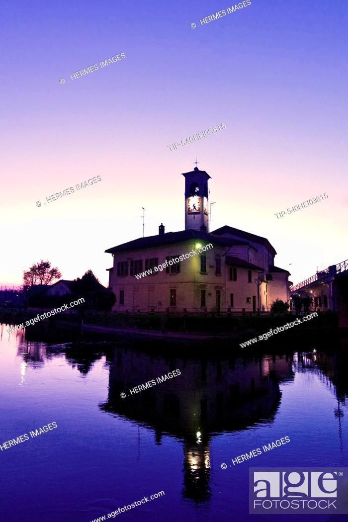 Stock Photo: Italy, Lombardy, Abbiategrasso, the Naviglio at dusk.