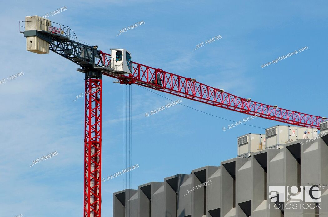 Stock Photo: Red crane against a blue sky on a building project  Porto, Portugal.