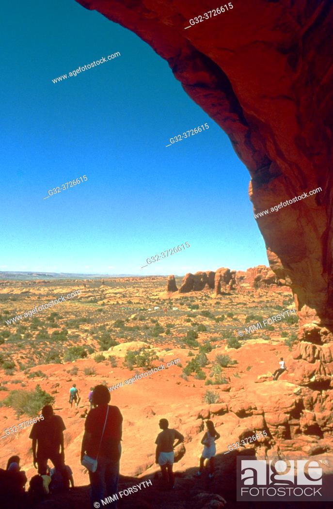 Stock Photo: visitors to Arches National Park, Utah.