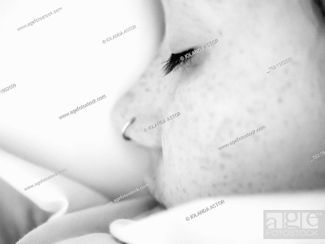Stock Photo: Close-up face of a sleeping teenager. White and Black.
