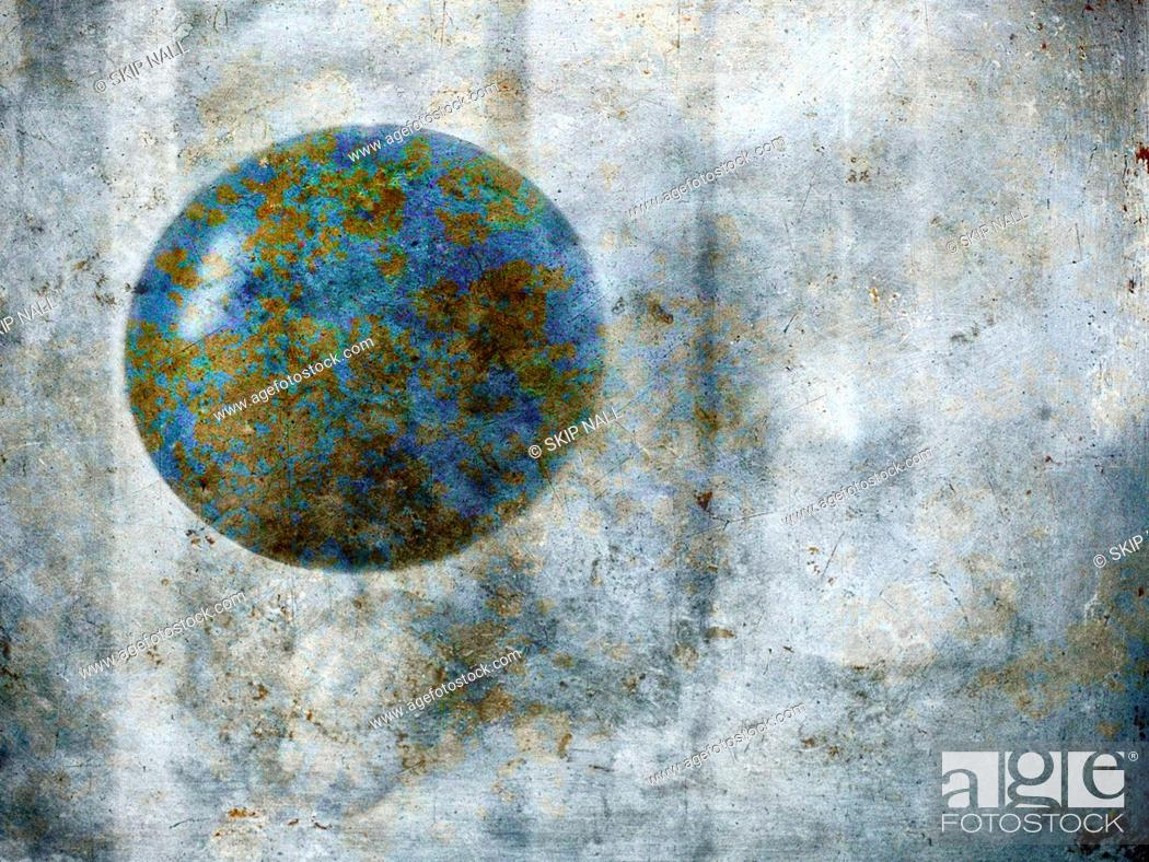 Stock Photo: An old doorknob that looks like the planet earth.