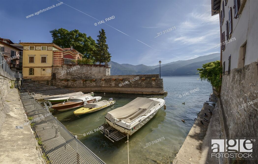 Stock Photo: cityscape with boats in small harbor at historical touristic village on Como lake, shot in bright fall light at Urio, Como, Italy.