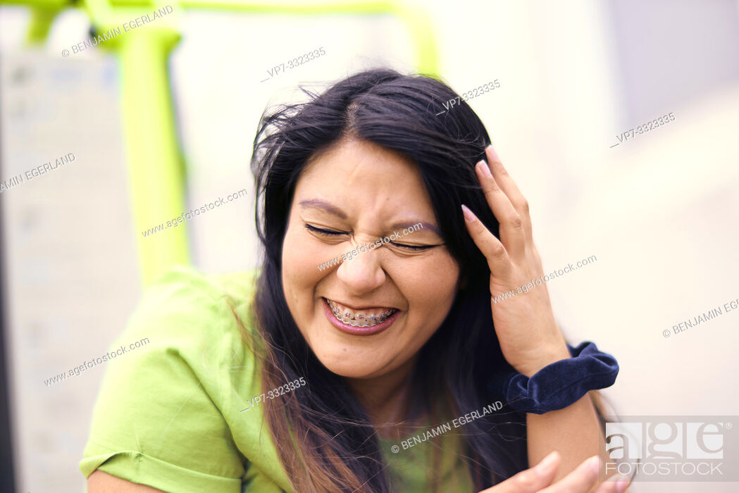 Stock Photo: vibrant woman laughing.