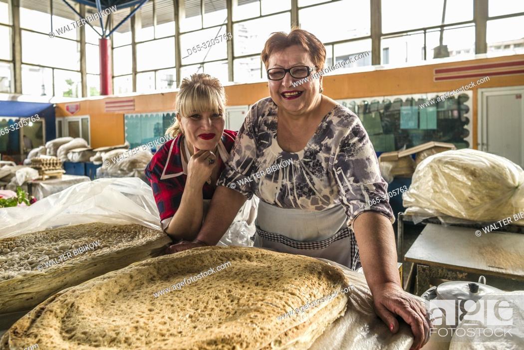 Stock Photo: Armenia, Yerevan, G. U. M. Market, food market hall, vendor of lavash flat bread, MR.