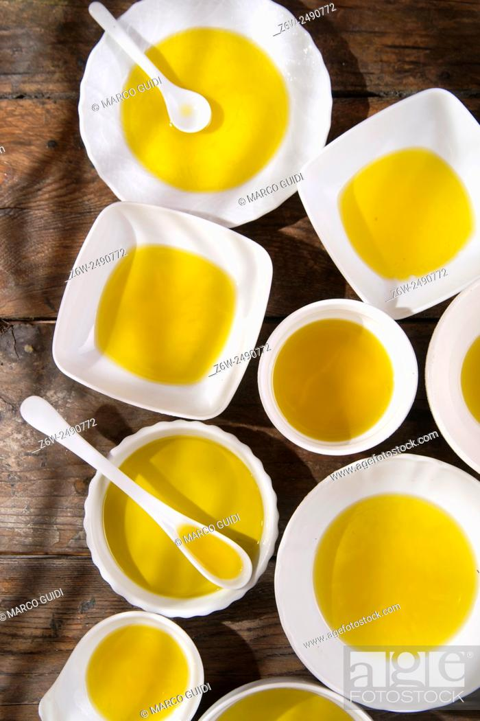 Stock Photo: Presentation of small containers of extra virgin olive oil.