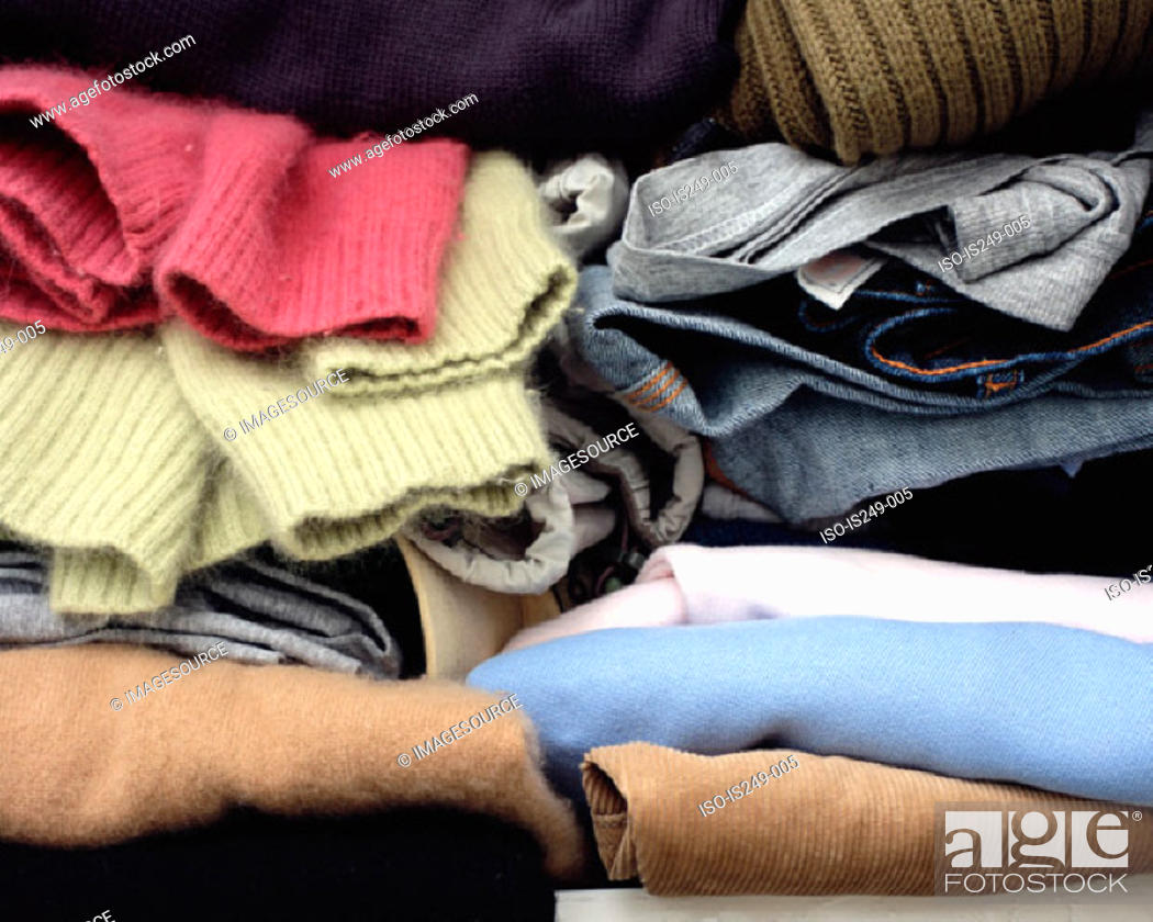 Stock Photo: Clothes folded in cupboard.