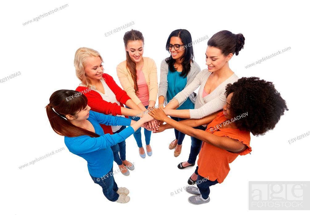 Stock Photo: diversity, race, ethnicity and people concept - international group of happy smiling different women over white holding hands together.