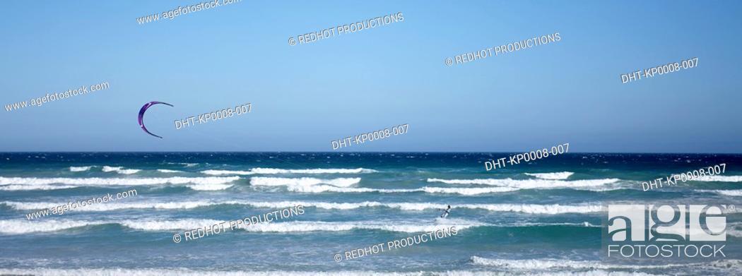 Stock Photo: Kite Windsurfer over beach.