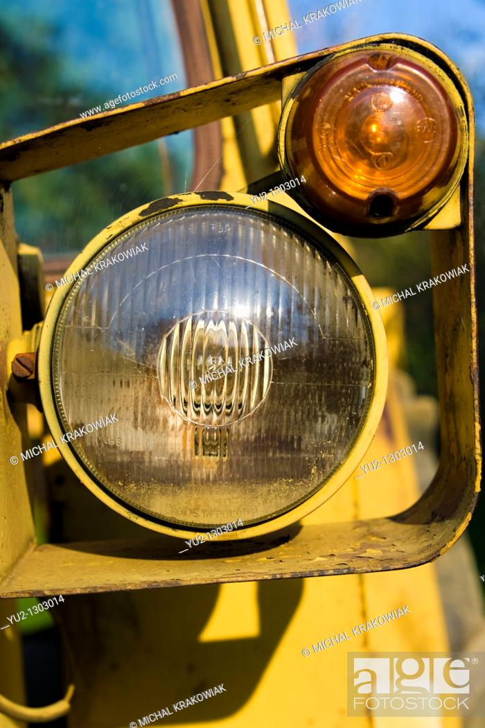 Stock Photo: Headlight of old bulldozer.