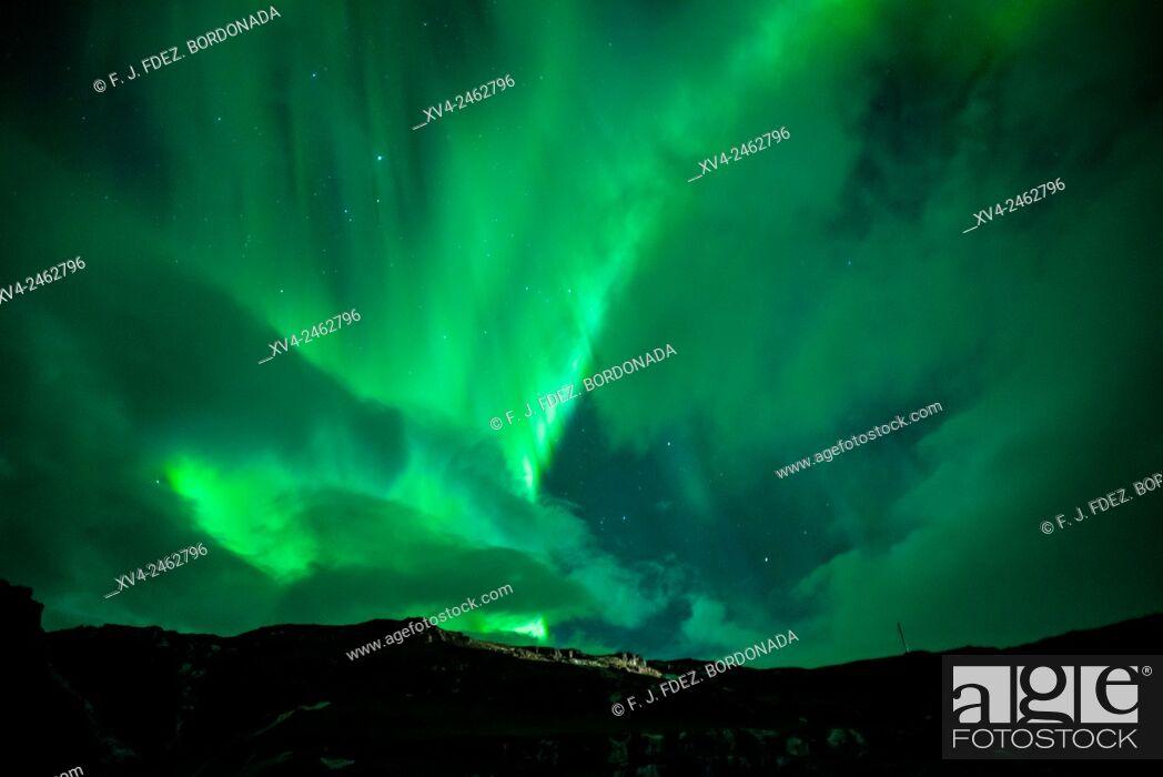 Stock Photo: Aurora Borealis, Northern lights phenomenon in winter. Iceland southeast.