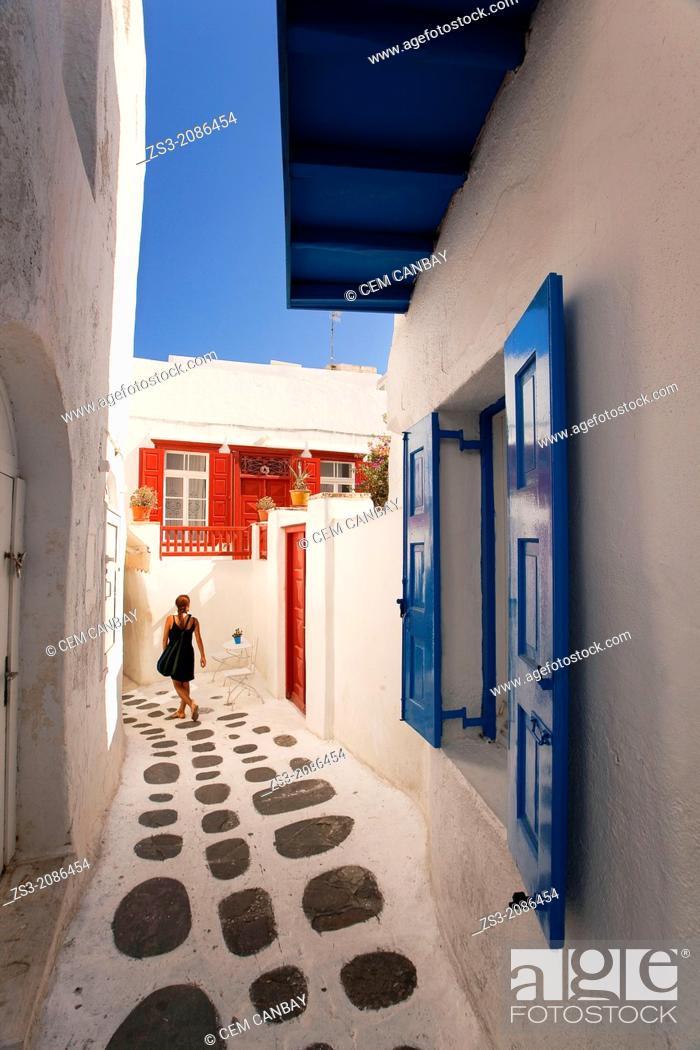 Stock Photo: Woman in the alleys of town center, Mykonos, Cyclades Islands, Greek Islands, Greece, Europe.