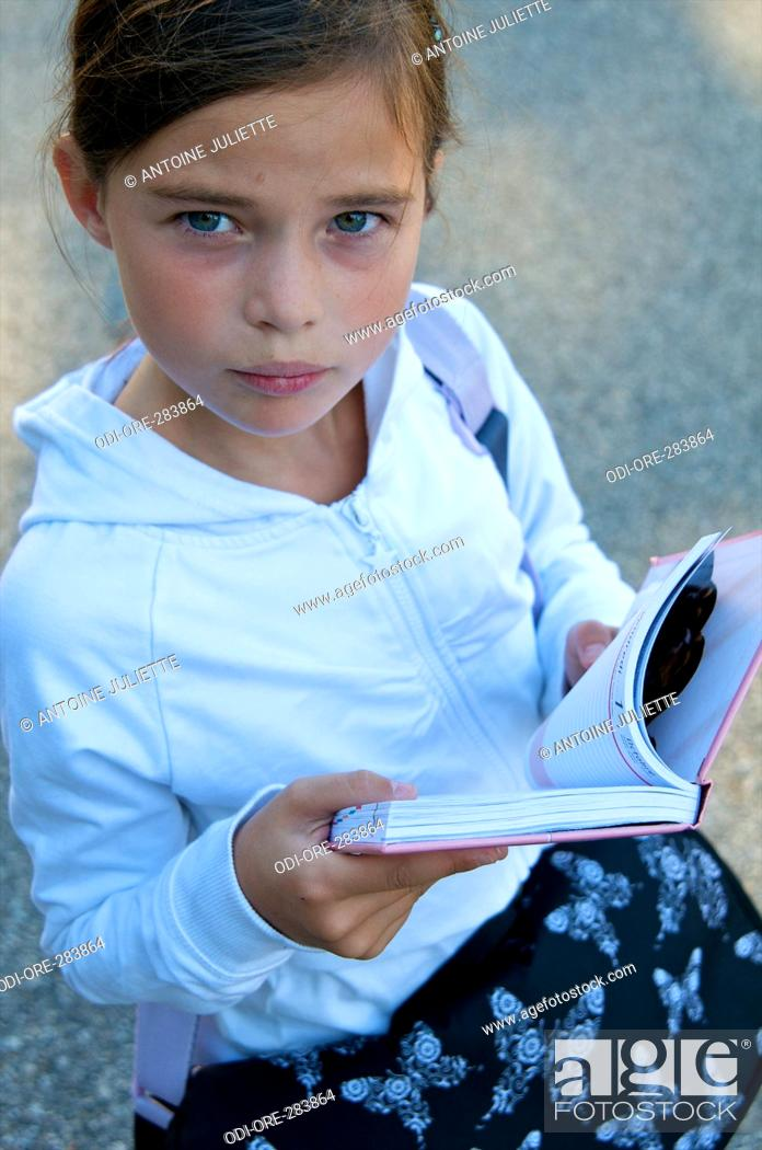 Stock Photo: Little girl diary.