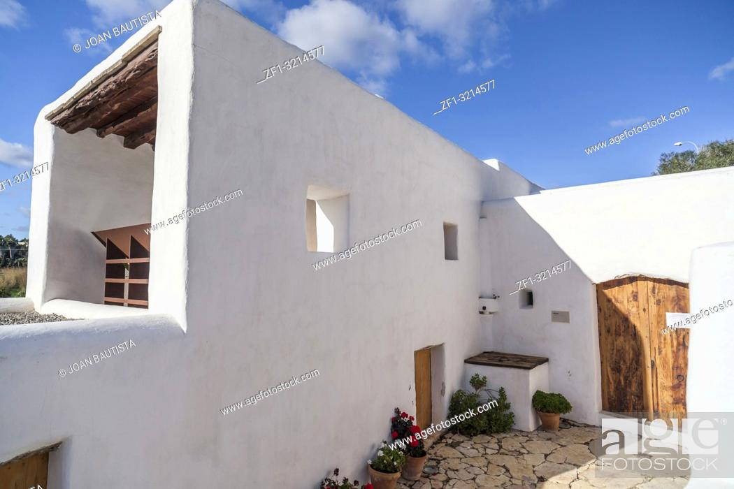 Stock Photo: Ancient house and windmill Can Planetes, nowadays is cultural and ethnographic center. Santa Eularia des Riu, Ibiza, Spain.