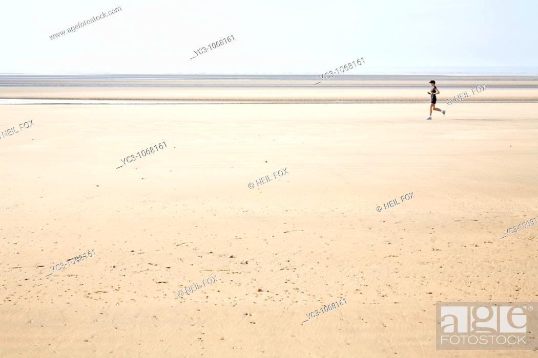 Stock Photo: Running on the beach.