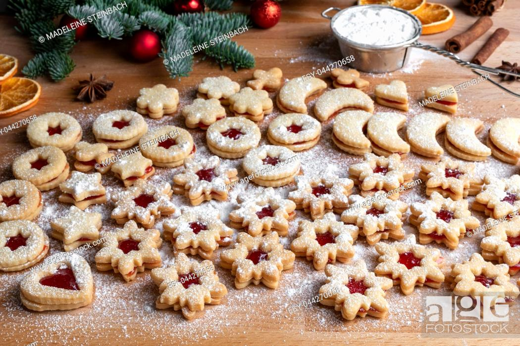 Stock Photo: Preparation of traditional Linzer Christmas cookies with strawberry marmalade.