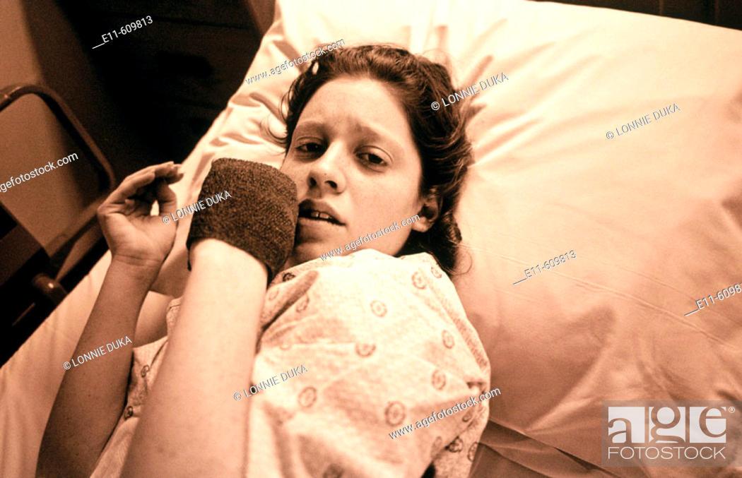 Stock Photo: Teen girl in hospital bed.