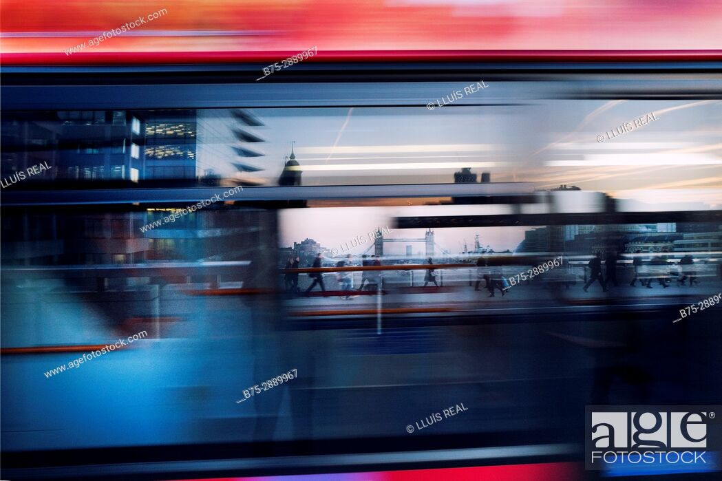 Stock Photo: People walking across the London Bridge, seen through a moving bus in London, England, UK.